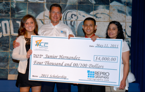 Caroline Hall, Brian Hall, Junior Hernandez & Junior's Aunt Gloria pose with Juniors scholorship check.