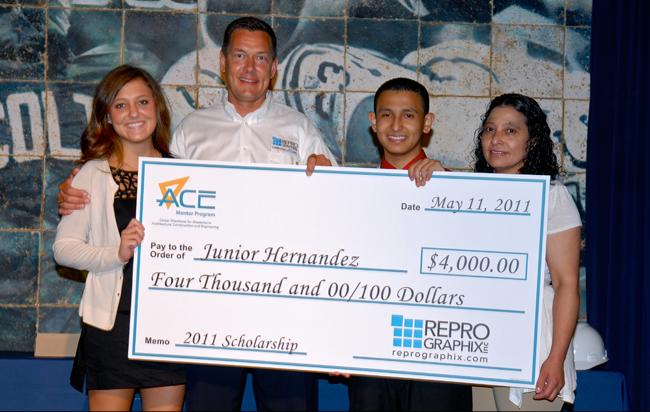 Caroline Hall, Brian Hall, Junior Hernandez & Junior's Aunt Gloria pose with Juniors scholorship check.
