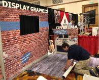 Jeff is installing our floor graphics like the pro he is!